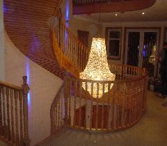 three storey curved oak stair french polished